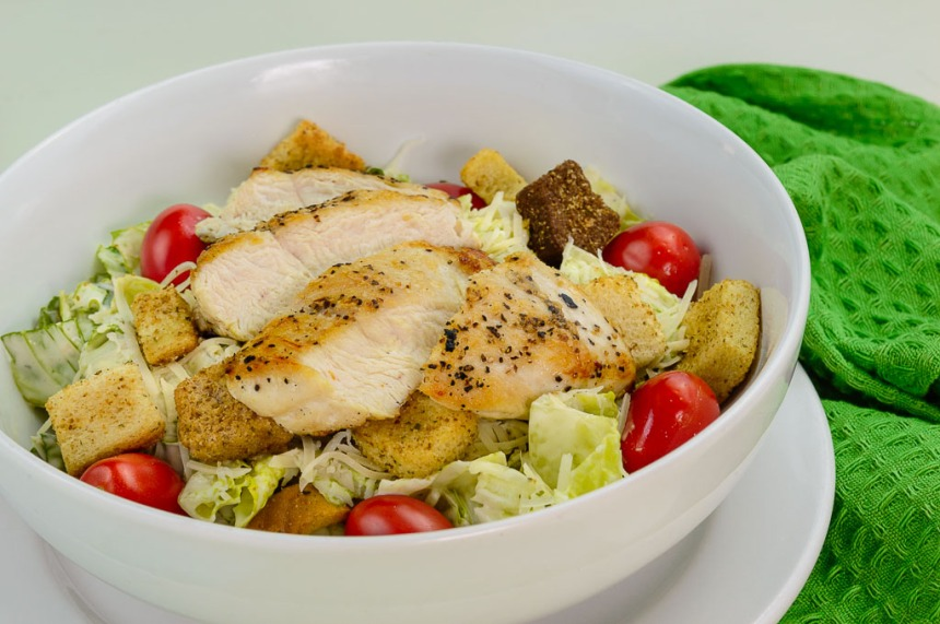 Chicken Caesar Salad with Grape Tomatoes and Parmesan.